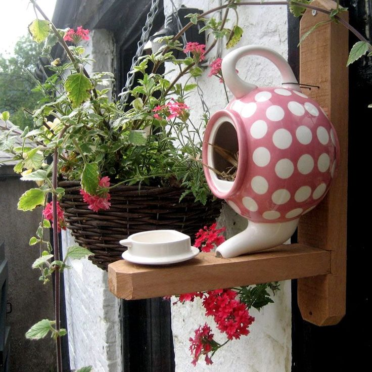 Very cute :)teapot birdhouse mounted on 2x4's.  glue the pot top to the board and put bird seed in it