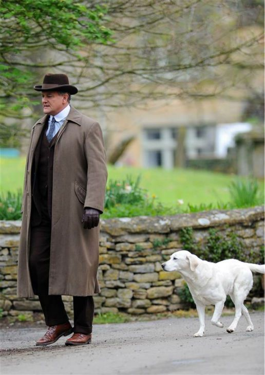 The Earl of Grantham) with his faithful dog, Isis.  Downton Abbey.