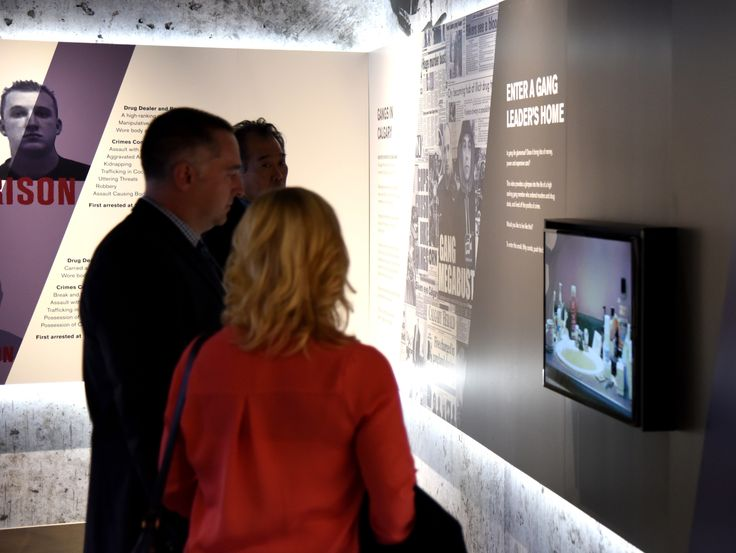 Visitors explore some of the video elements of the displays.