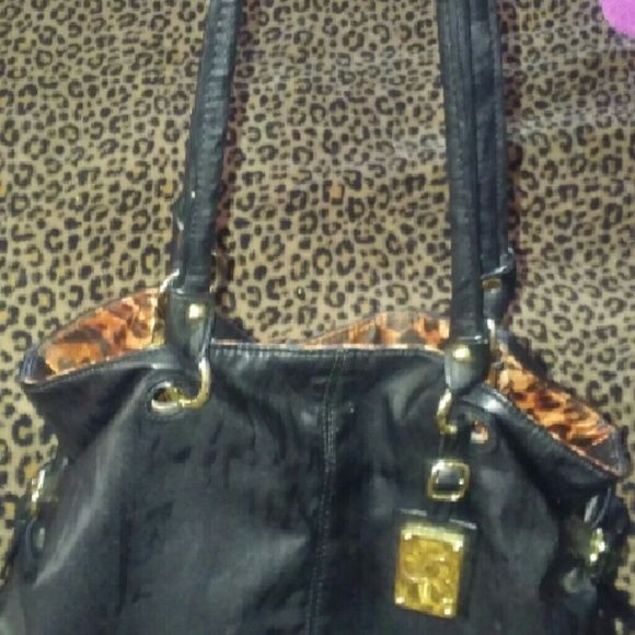 Serina williams  Reversable Serina williams. The tennis star.. Reversable blk. Bag  to leopard - cheetah satiny material .  like new condition. Only used  a few days. See all my other bags shoes  victorias secret , coach to be posted this week . bundle and i pay  ship 4. Serena williams Bags