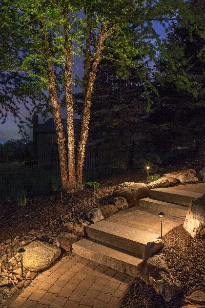 Outdoor lighting ideas tip paths and walkways with a few lights too many lights makes it look like an airport runway 5 tips to nightscape your home