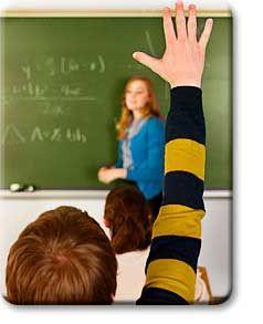 Teen raising hand in class
