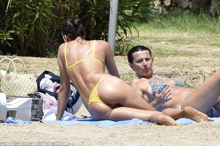Chilling: She was joined by a friend who she chatted away with on the sand