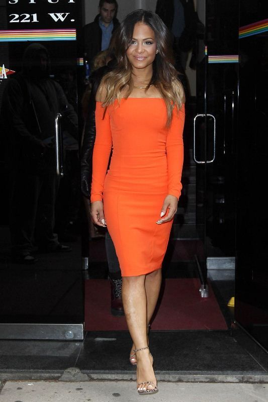 Christina Milian couldn't be missed while arriving at The Wendy Williams Show in a Waldrip Orange Off The Shoulder Dress: Finding an orange off-the-shoulde