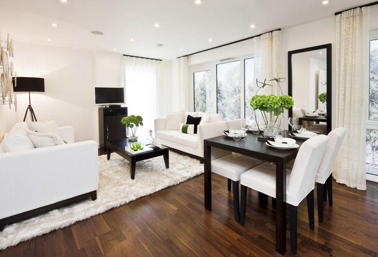 Mainly white living/dining room makes the space larger. Bright green colour foliage adds interest.