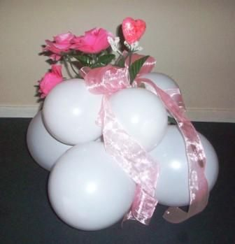 Fancy Flowers- Set the mood for special events like bat mitzvahs, sweet-16 parties, and baby showers too with this centerpiece topped with your choice of silk floral and ribbon.