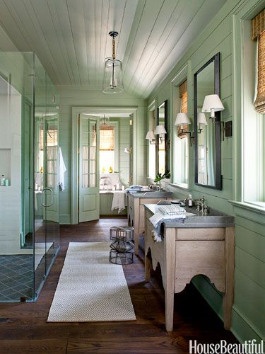 truly charming!  with a delightful vintage feel, this bathroom finds a perfect balance between modern touches like the glass shower and rustic homages like the wood paneled walls and ceiling and the custom built, antique oak washstands.  I adore this bathroom.  I only wish the toilet wasn't in the same room as the bath (pet peeve)--but still: it's very liveable and utterly loveable :)
