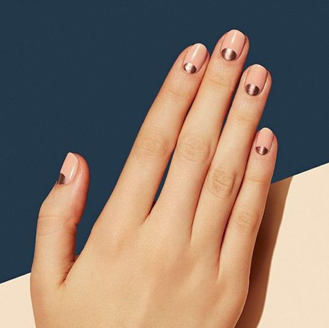Show off your oval nails with a pastel + metallic half-moon manicure design.