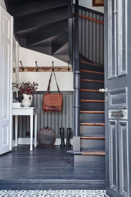 Old house entrance looks great, with deep gray paint, wallpaper that resembles beadboard, and a simple white table. interiorcrisp.blogspot.fr