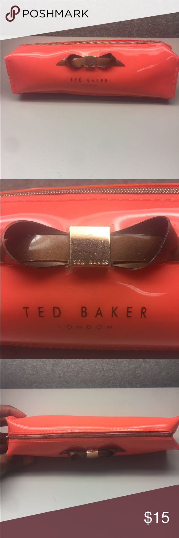 Ted Baker 'Slim Bow' Pencil Case Ted Baker 'Slim Bow' Pencil Case Neon color which is brighter in person Top zip closure  100% Polyvinyl Chloride 9 x 2.3 x 2.3 inches  Never been used Ted Baker Bags Cosmetic Bags & Cases