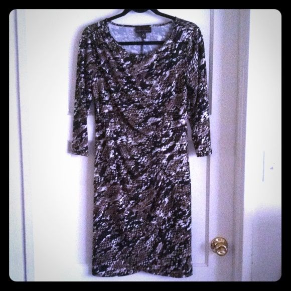 Snakeskin Print Dress Form fitting snakeskin print pullover dress, worn only once, like new. Three quarter sleeves, gathered at left side, with draped look. Black, brown, tan & white colors. Size small. Dana Buchman Dresses Midi
