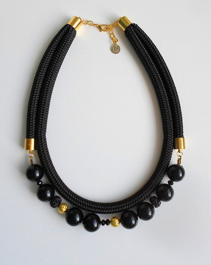 Black statement necklace with beads and rope