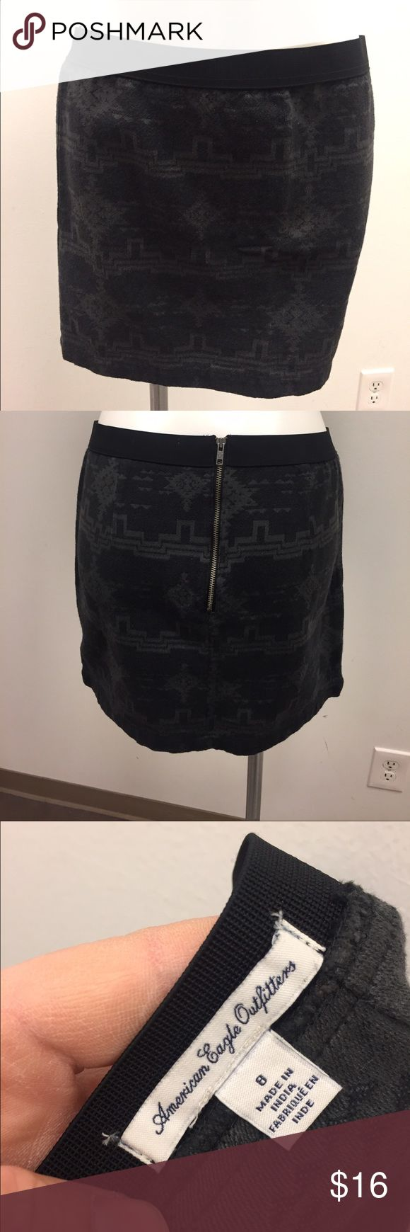 American Eagle Outfitters Tribal Print Skirt Grey and black tribal print mini skirt from American Eagle size 8. No major flaws or damage. It zips up the back and has some stretch to it. #americaneagle #ae #tribal #skirt #americaneagleoutfitters American Eagle Outfitters Skirts Mini