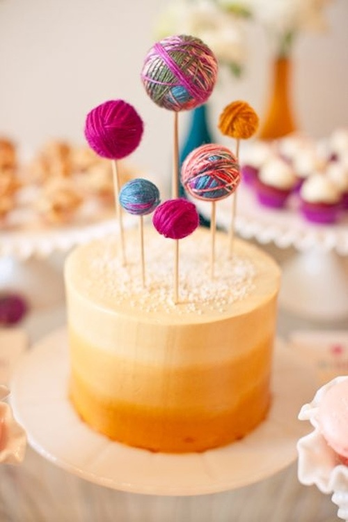 DIY Yarn Ball Cake Toppers on a Gold Ombre Cake