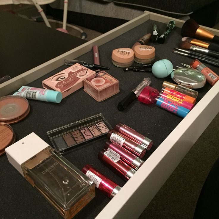 Unorganised dressing table drawer #Benefit #Rimmel #Maybelline #Essence #Babylips #Seventeen #Tangleteezer #Chanel #Britneyspears #Bodyshop #EOS #BarryM #Leestafford