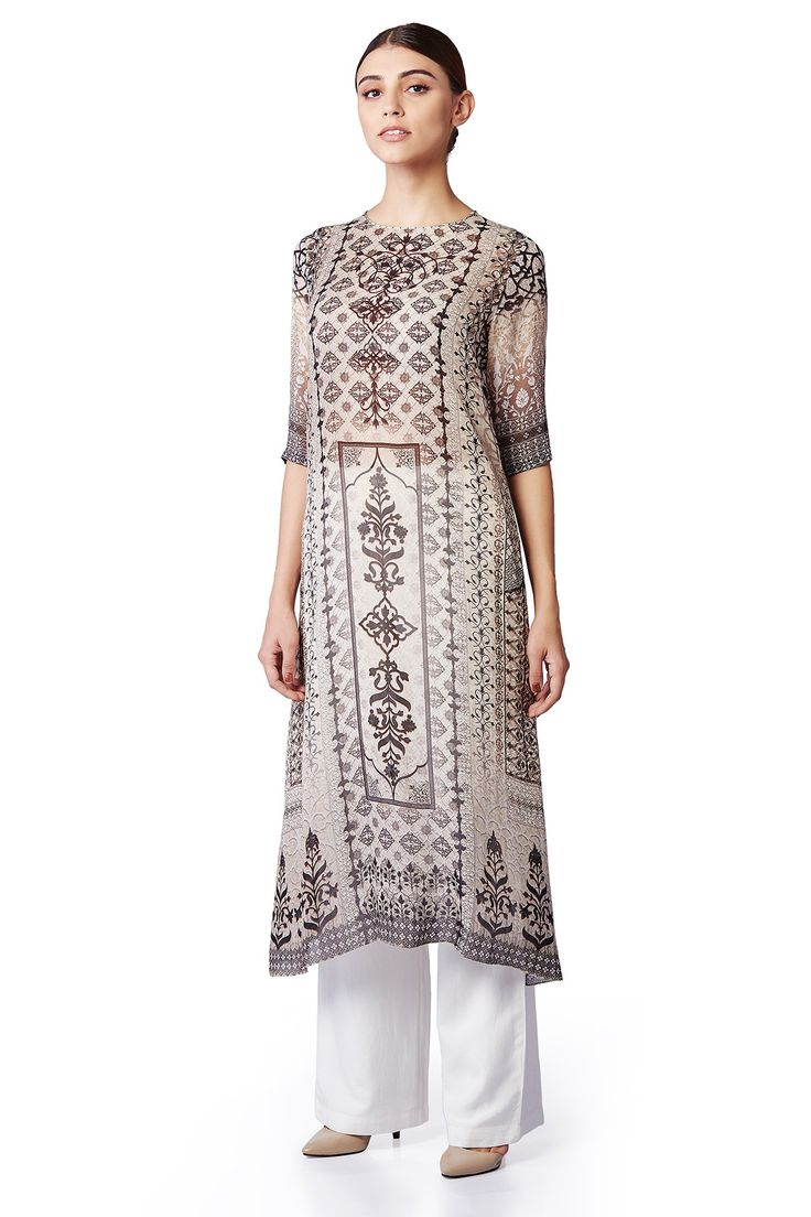 An elegant, full sleeved, digital printed tunic with a key-hole at the back. INR 7,990.00