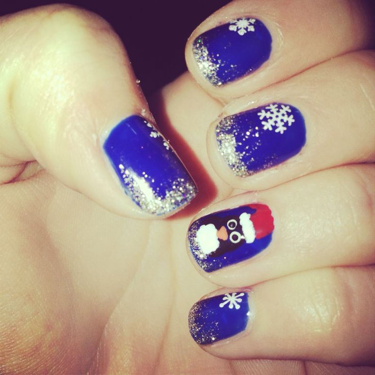 Blue Christmas Nails With Penguin Nail Art