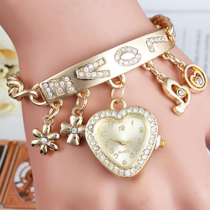 Encontrar Más Relojes para Mujer Información acerca de Nuevo 2015 diseño moda oro de la pulsera mujeres reloj de pulsera de cuarzo, señora de la cadena vestido reloj relogio masculino, alta calidad Relojes para Mujer de HI WELCOME MIKE STORE(Mixed order $5) en Aliexpress.com