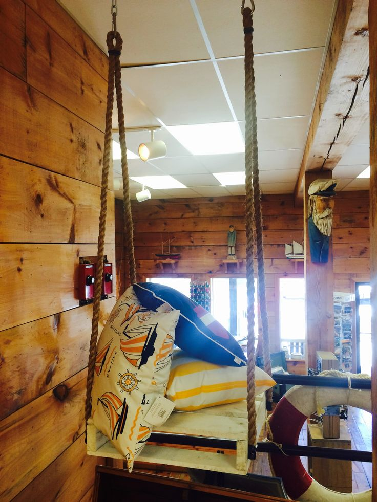 Nautical hanging seat made from rope and painted skid. Saw in Mariner Chart Shop in Tobermory, Ontario