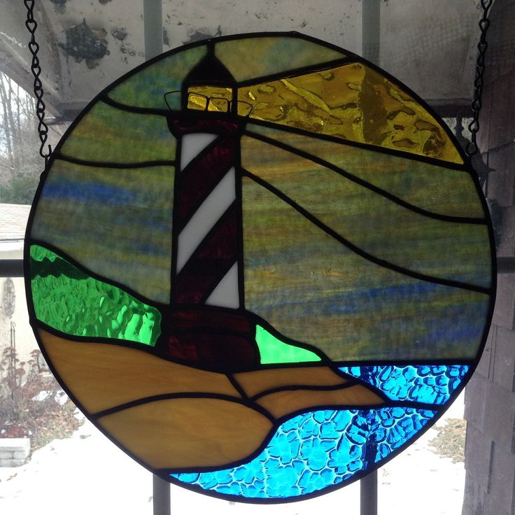A personal favorite from my Etsy shop https://www.etsy.com/listing/221849465/stained-glass-lighthouse