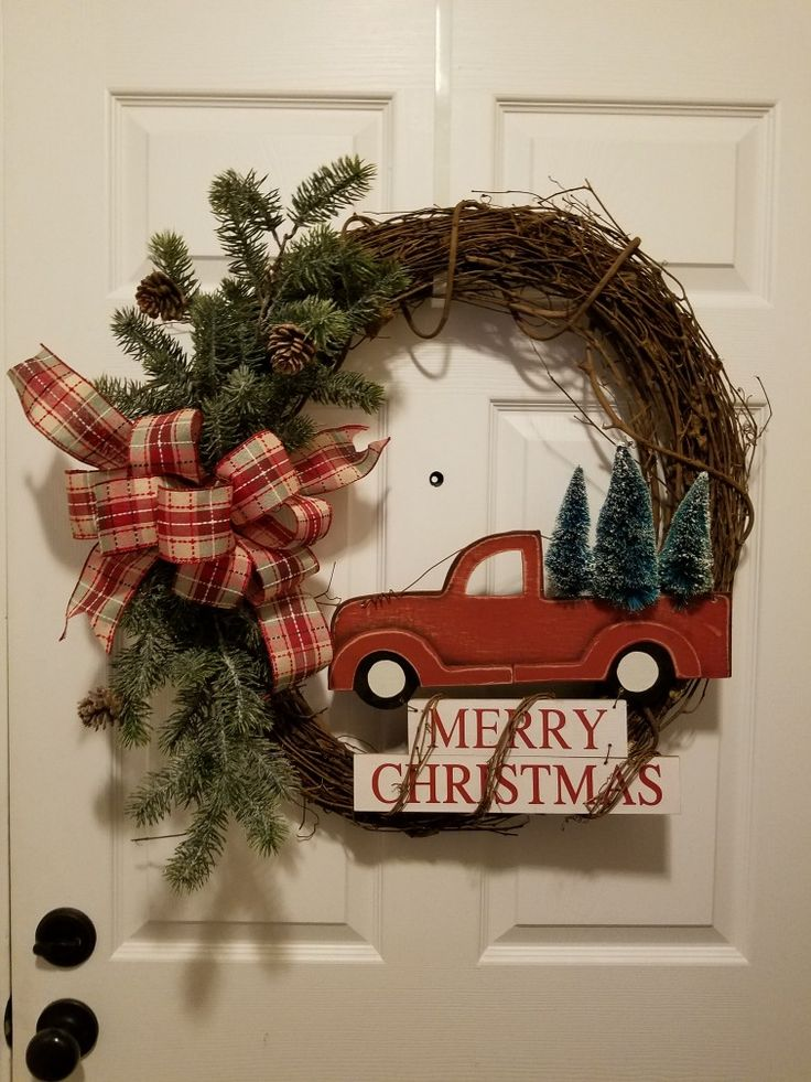 """Memories of Christmas past. Simplistic 24"""" grapevine wreath with the anticipated christmas tree delivery."""