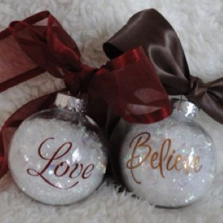 Easy project!  Glass balls, fill with snow flakes (any craft store), cut out letters with vinyl and tie a bow!  Voila a great idea for christmas