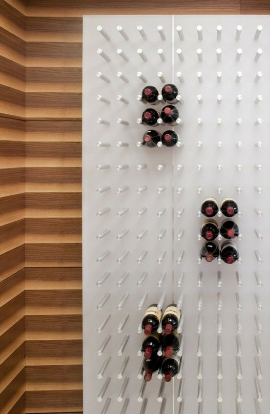 great idea for a wine wall - sturdy wall board and dowels. so simple. by joanna