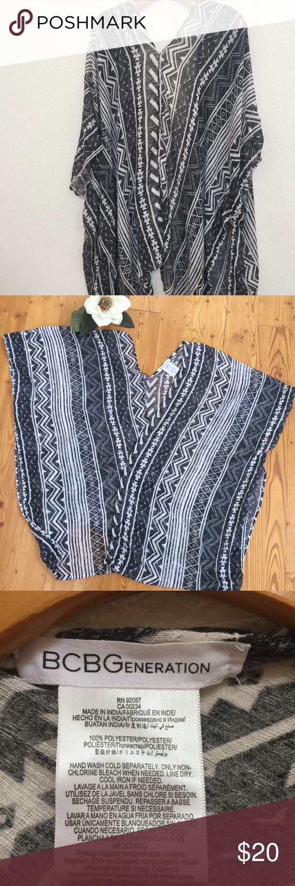 BCBG Aztec prints Shawl Pre owns BCBG Cardigan, For L & XL, black and white Aztec prints, good condition. Beautiful and Light weight cover up. BCBGeneration Sweaters Shrugs & Ponchos