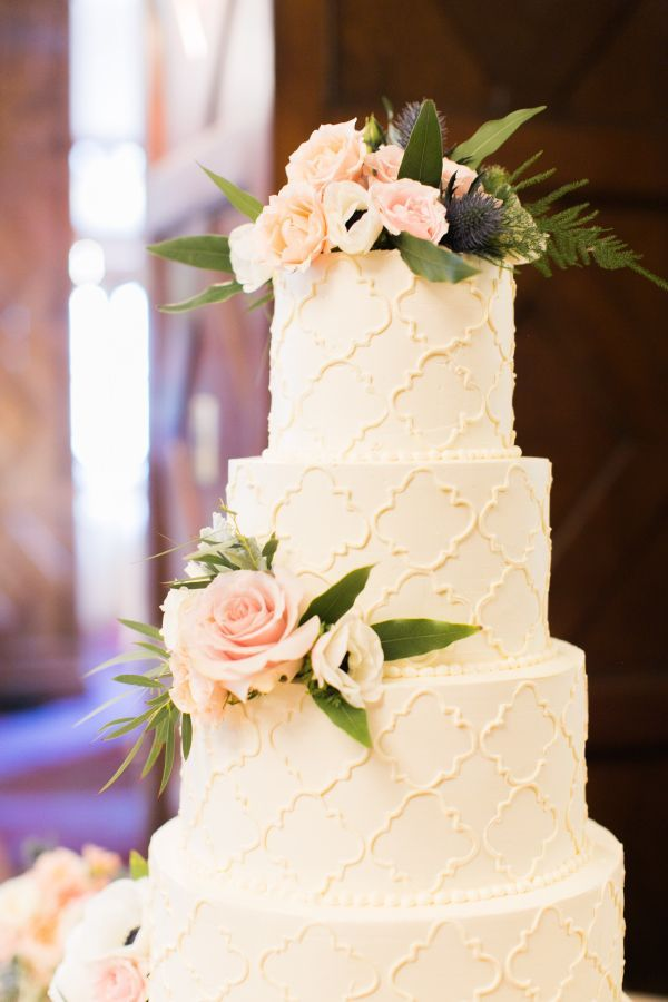 Four tier floral topped wedding cake: http://www.stylemepretty.com/little-black-book-blog/2016/08/22/traditional-spring-blush-wedding-cherry-blossoms/ Photography: Alea Lovely - http://www.alealovely.com/