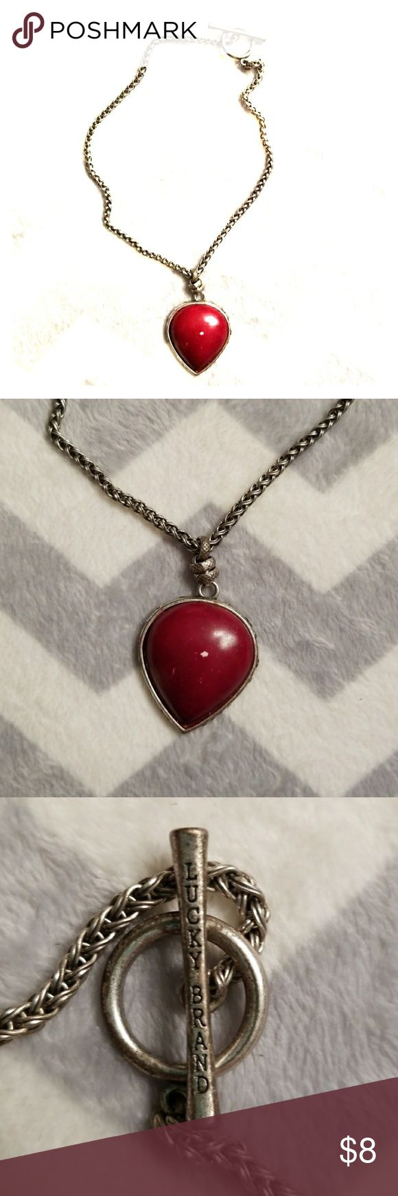 Lucky Brand Red Tear Drop Necklace Lucky Brand Red Tear Drop Necklace,  Silver in color.. this necklace has been worn many many times,  but still has lots of life.. has a nick in the center.. never tried to color it in.. It's an awesome piece! Lucky Brand Jewelry Necklaces
