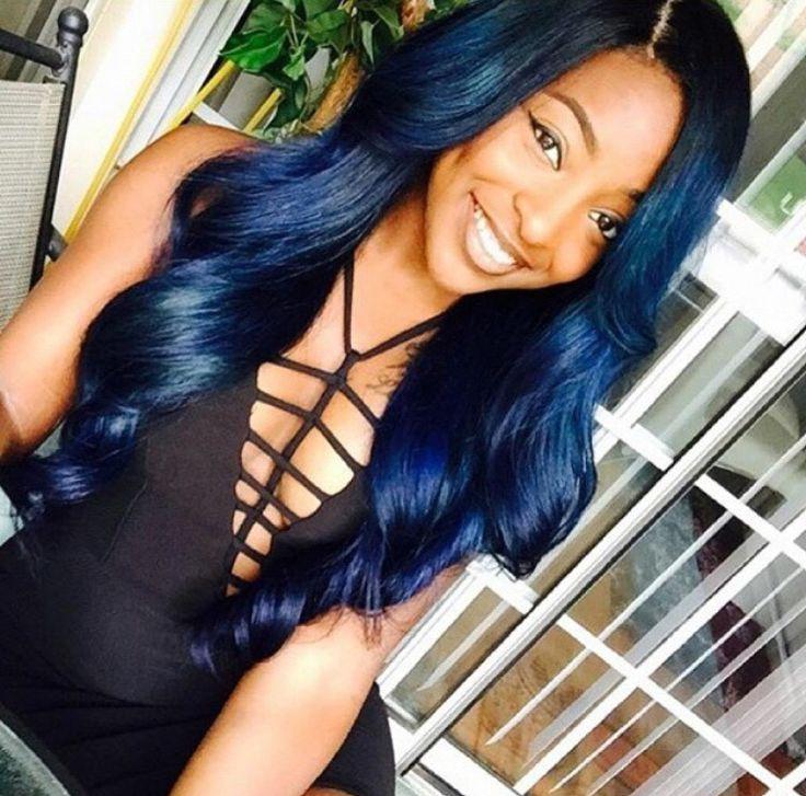 Navy blue hair. Long weave hair. Side part.