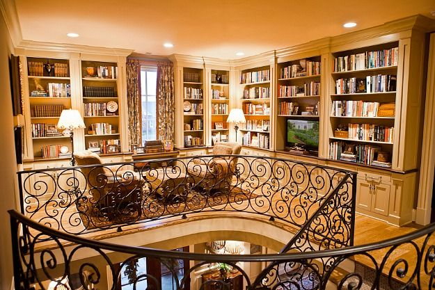 Eric Ross says his client was downsizing from her previous home, so she didn't really need new furniture or accessories. She just wanted to showcase some of her favorite things, like her books. Her new house has a large upstairs landing that wasn't being used, so he turned it into a cozy library.