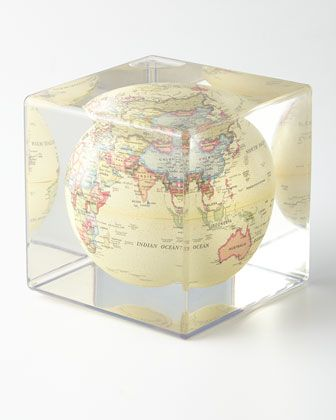 "Globe with antiqued beige finish floats in clear fluid. Made of polycarbonate, steel, and PVC. 5""Sq. x 5""T. Imported."