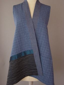 Long Vest with Teal Accent - Long Kimono Vest in Blue Japanese Cotton This blue is gorgeous on! It has a wonderful red/purple quality to it that flatters the skin. The look of indigo and chambray with close wavy lines stitched over voile. This Japanese yarn dyed cotton vest is wearable over so many things. Pocket and linen neckband.