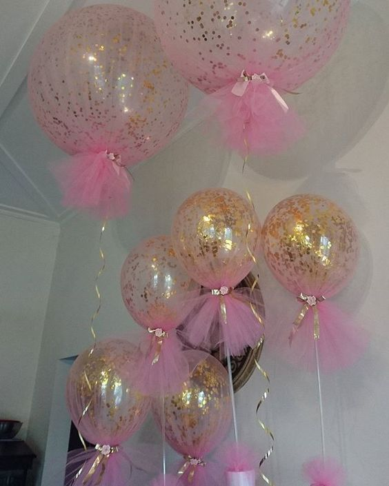 The most popular girls christening centrepieces. Just perfect with confetti and tulle.  Cake table size and table centrepiece size  #originaldesign #christeningballoons #tulleballoons: