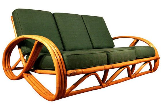 3 strand Pretzel-Arm Rattan sofa with olive green upholstery.