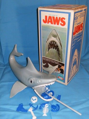 """Jaws Game - capitalizing on the Spielberg film... You try and fish out junk from the mouth of the shark with a hook preventing his """"Jaws"""" from snapping shut"""