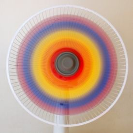 Paint a fan's blades different combinations of red, yellow, and blue.  Then, turn it on to reveal a lovely rainbow.