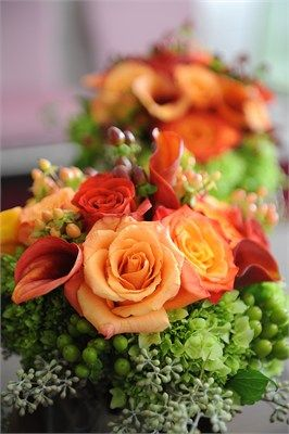 Green hypericum berries and orange roses makes this wedding bouquets perfect for vibrant summer wedding/ www.callaraesfloralevents.com