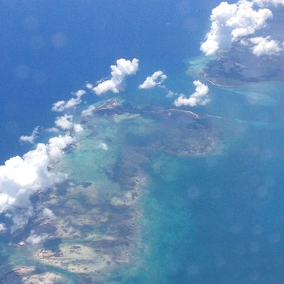 Taking the window seat on a flight gets you the chance to see some unique beautiful aspects of Earth. Here is a chain of island in the Caribbean, somewhere north of Jamaica.
