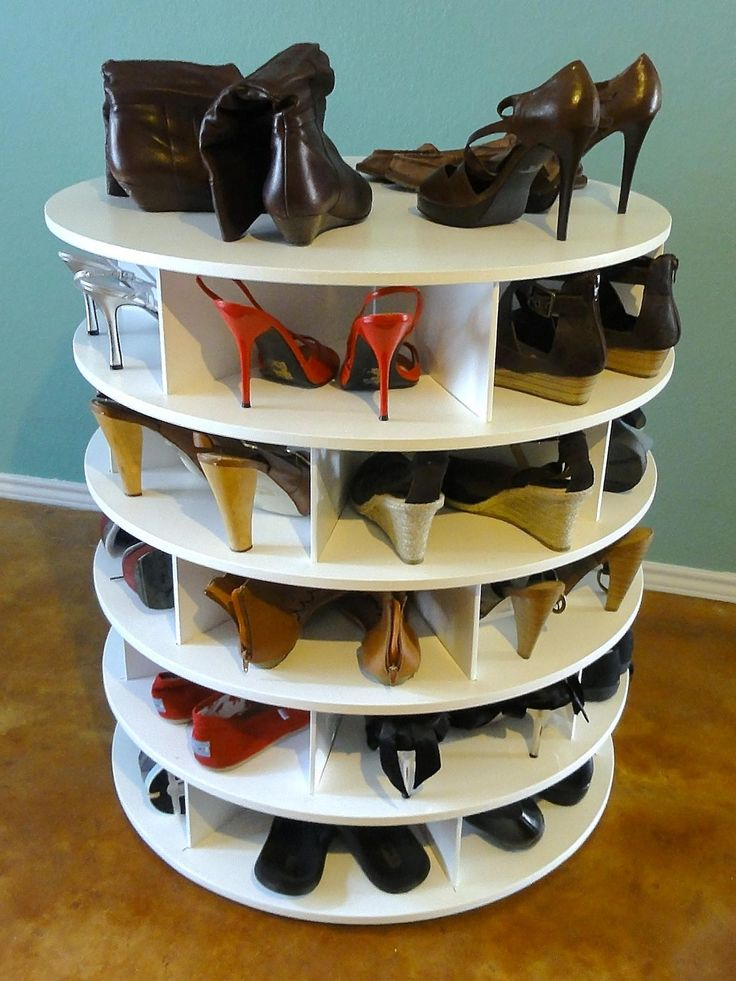Round white wooden shoe rack on brown