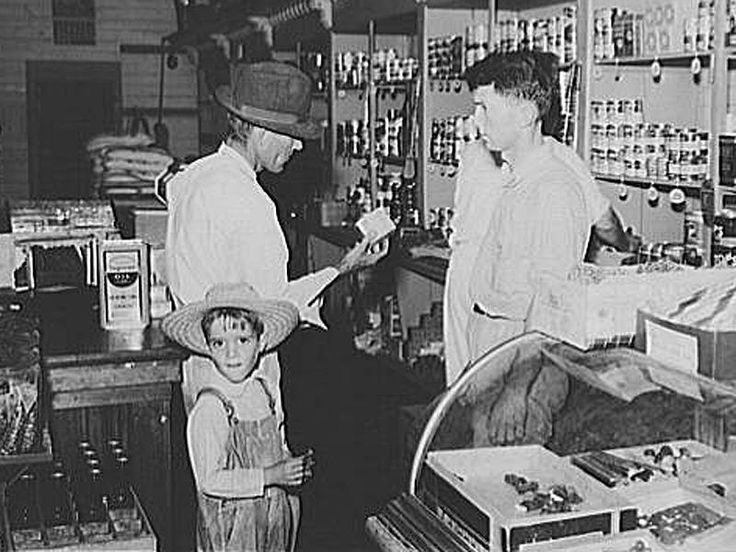 A farmer shops at the Irwinville Farms cooperative store (Irwin County) in 1938. Description from georgiaencyclopedia.org. I searched for this on bing.com/images