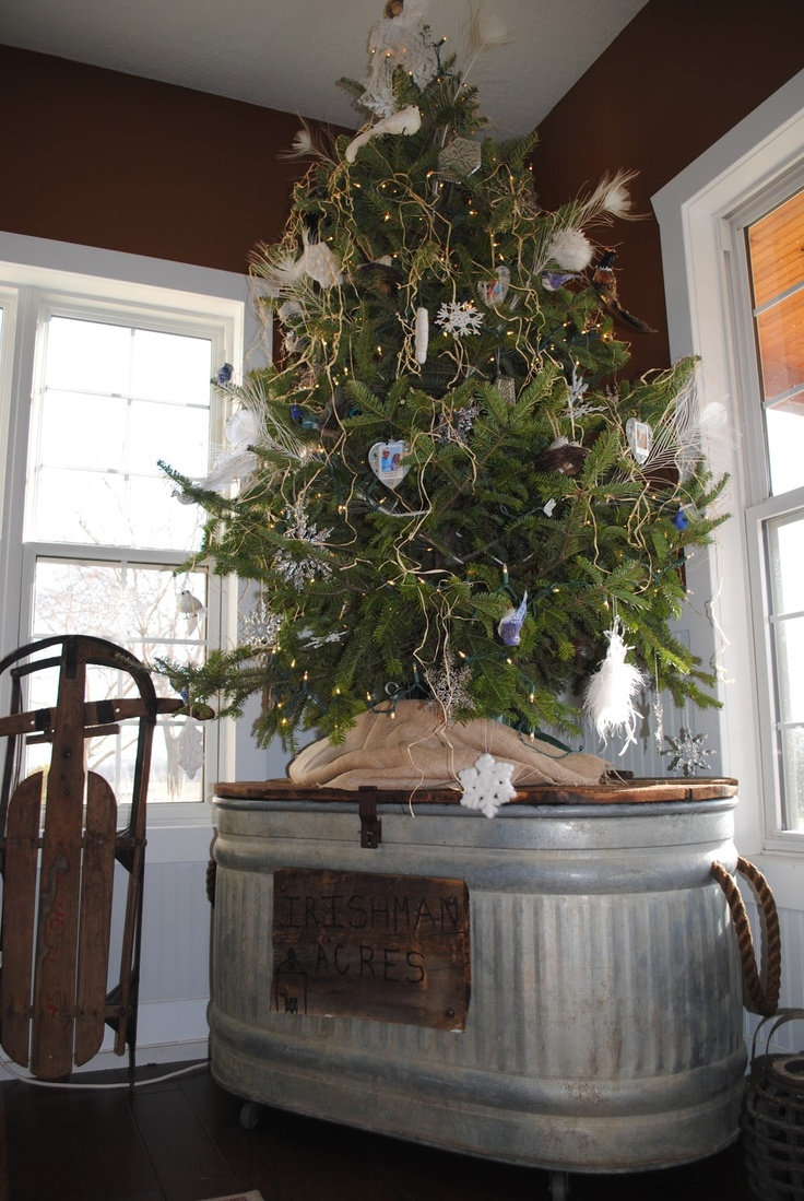 Irishman Acres Christmas Tree 2012: snowflakes, birds, feathers, burlap: on top of our repurposed water trough