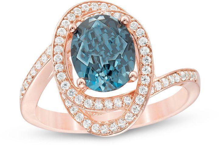 Zales Oval London Blue Topaz and 3/8 CT. T.W. Diamond Orbit Frame Ring in 10K Rose Gold