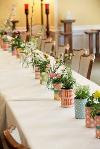 "tin cans wrapped in decorative paper/ribbon as vases or with potted plant inside for ""favor"""