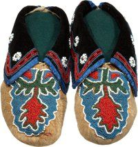 A PAIR OF CADDO/DELAWARE BEADED HIDE MOCCASINS c. 1900
