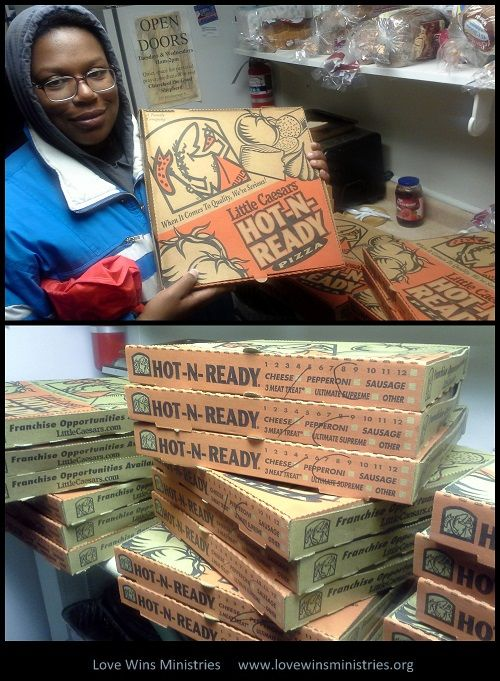 Tiffany patiently waits for the 30 pizzas that Little Caeser's donated.