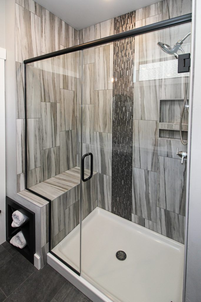 Grey Pattern Tiled Shower With Dark Grey Mosaic Tiled Design And Glass Shower Door In 2020 Bathroom Shower Walls Dark Grey Tile Bathroom Gray Shower Tile
