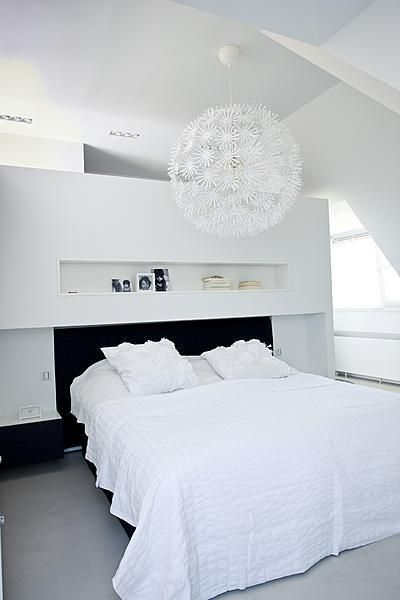 White bedroom with big IKEA lamp