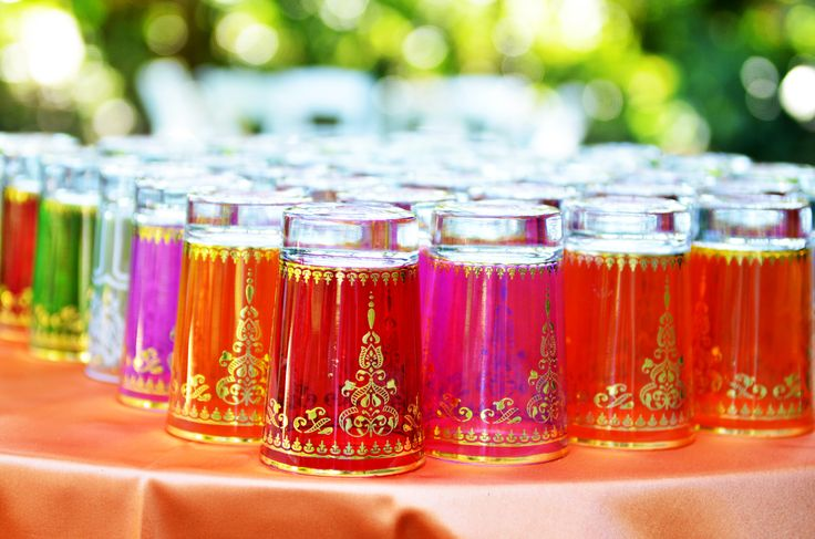 Coloured glasses or can be used as tealight candle holders